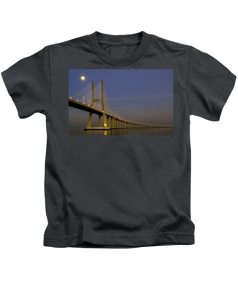 Vasco Kids T-Shirt featuring the photograph Vasco Da Gama Bridge In The Moonlight by Alexandre Martins