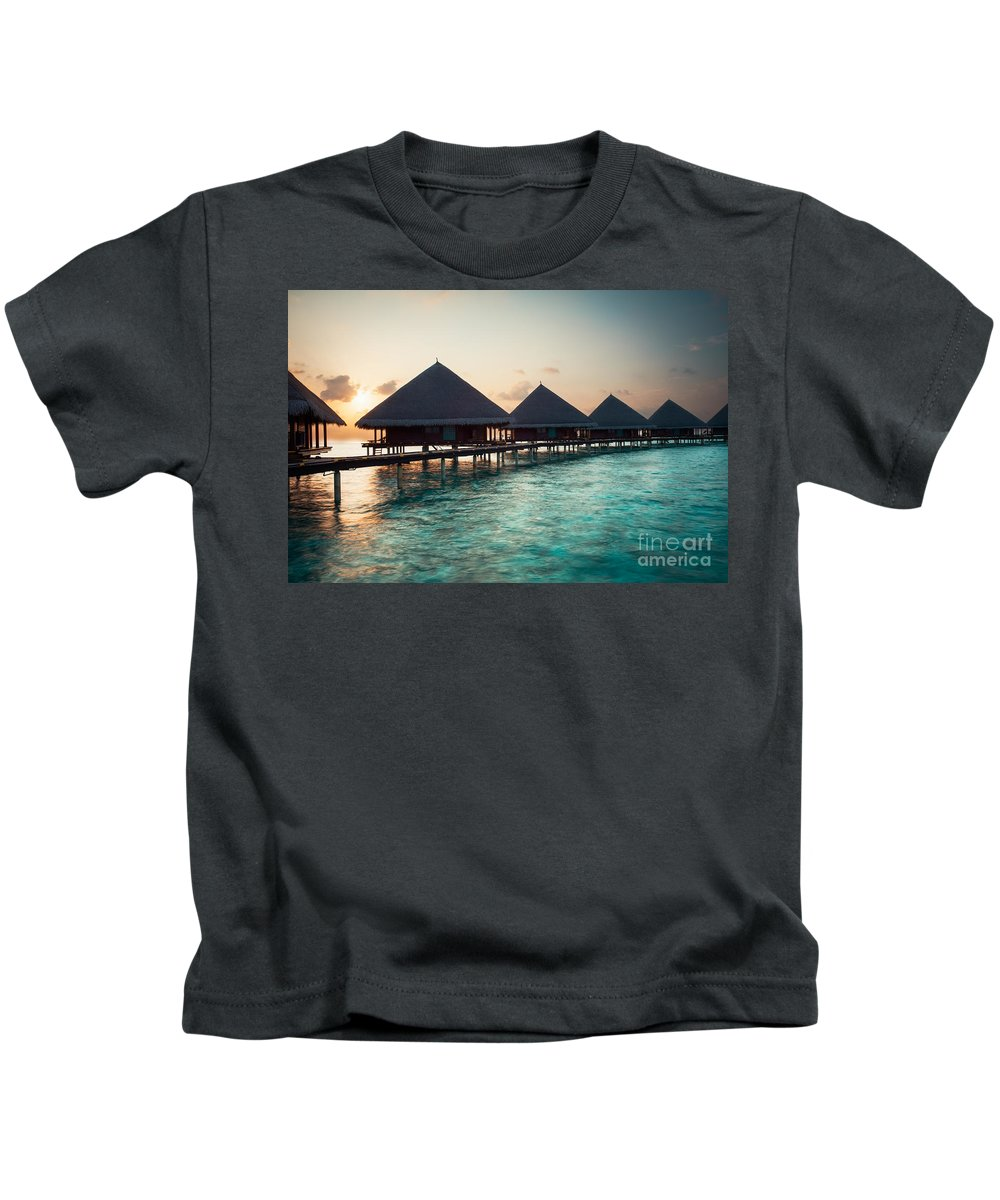 Amazing Kids T-Shirt featuring the photograph Waterbungalows At Sunset by Hannes Cmarits