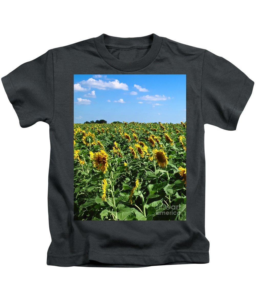 Sunflower Kids T-Shirt featuring the photograph Windblown Sunflowers by Robert Frederick