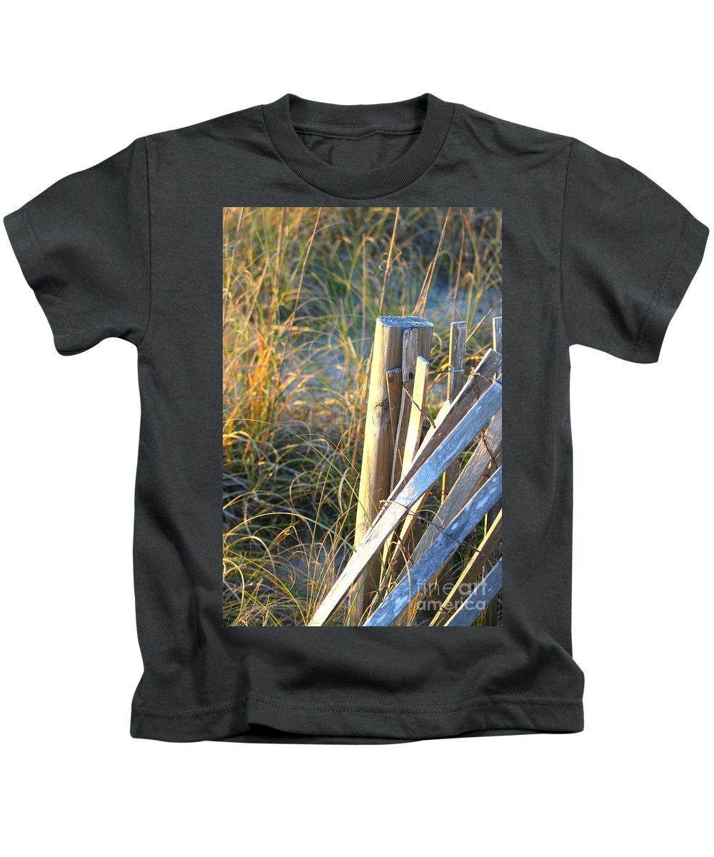 Post Kids T-Shirt featuring the photograph Wooden Post And Fence At The Beach by Nadine Rippelmeyer