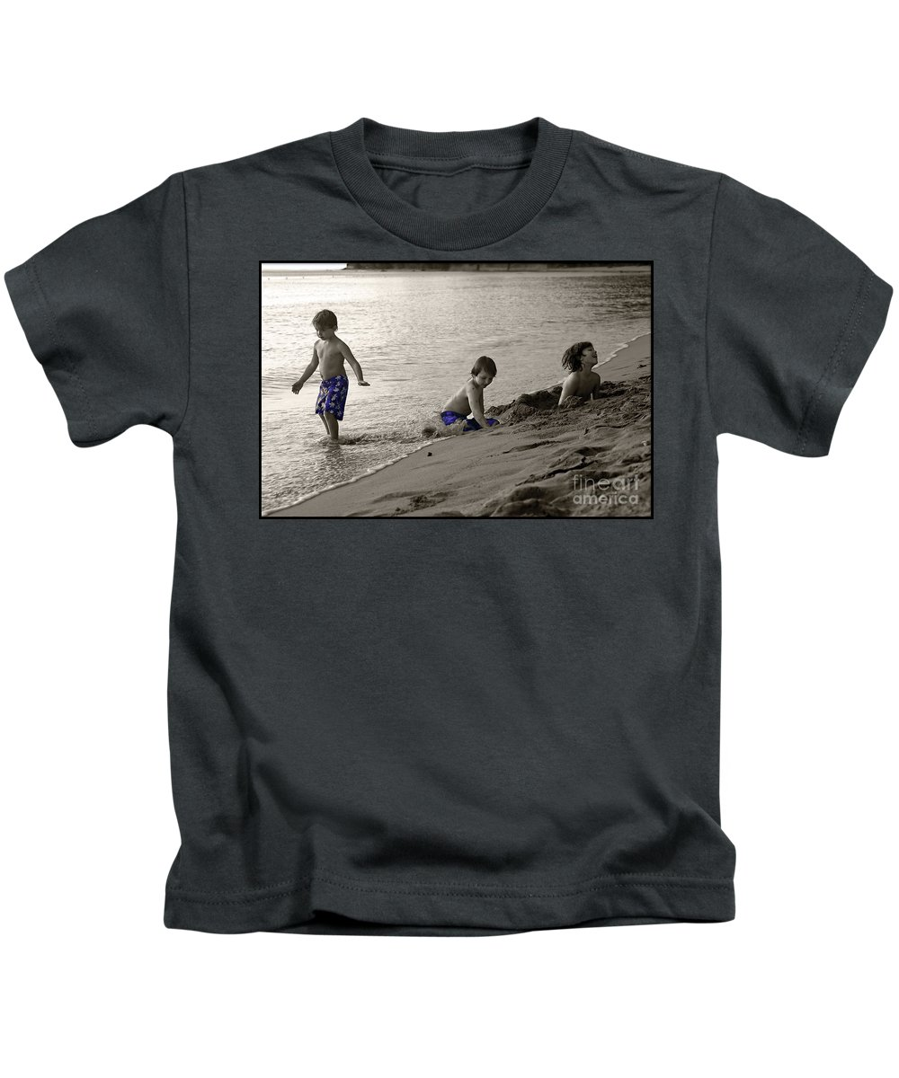 Boys Kids T-Shirt featuring the photograph Youth At The Beach by Madeline Ellis