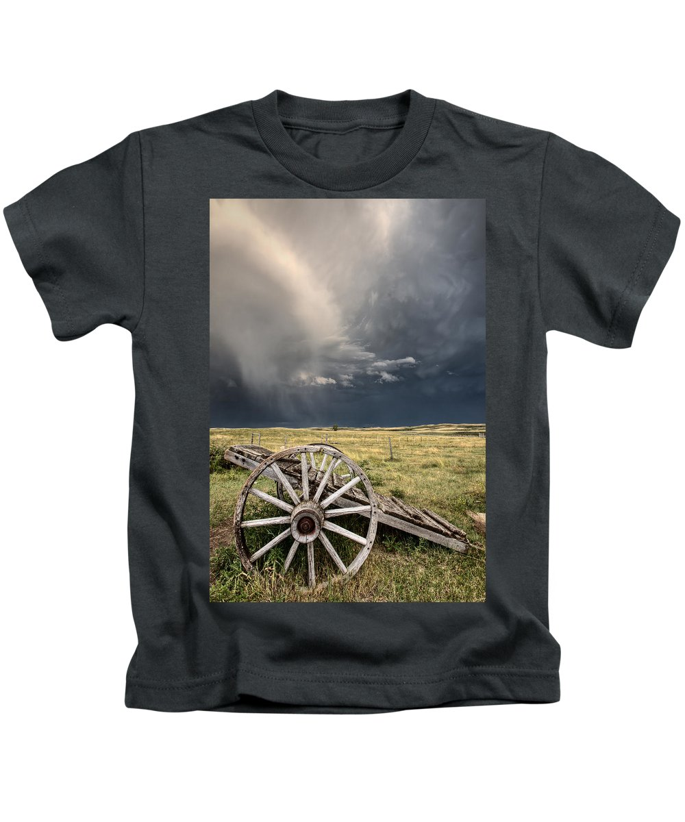 Wheel Kids T-Shirt featuring the digital art Old Prairie Wheel Cart Saskatchewan by Mark Duffy