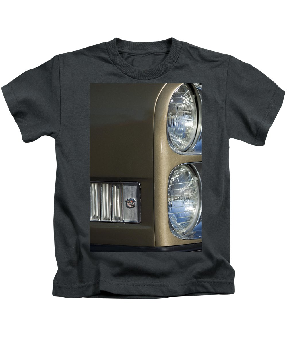 1966 Cadillac Kids T-Shirt featuring the photograph 1966 Cadillac Emblem And Headlight by Jill Reger