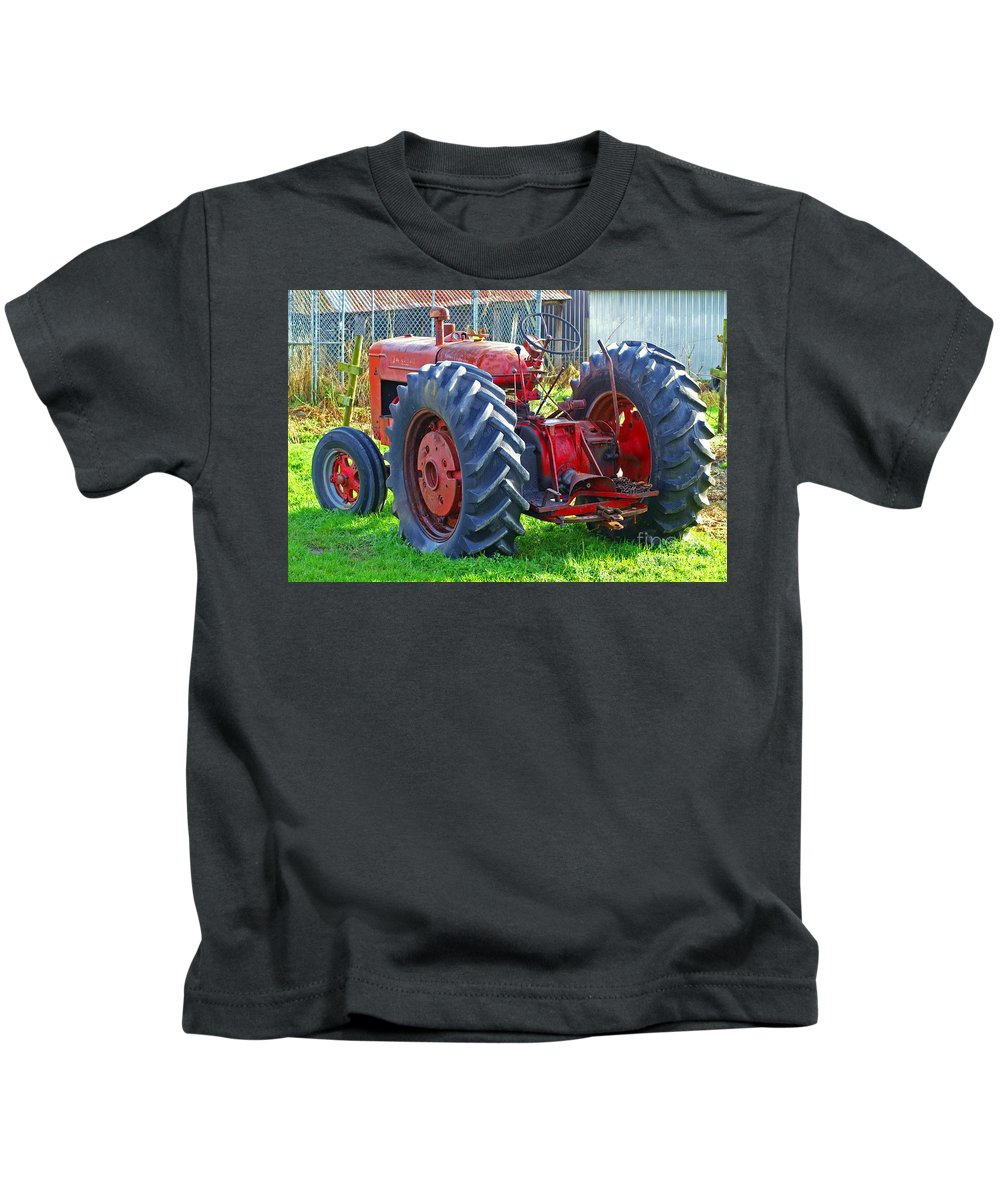 Tractors Kids T-Shirt featuring the photograph Big Red Rubber Tire Tractor by Randy Harris