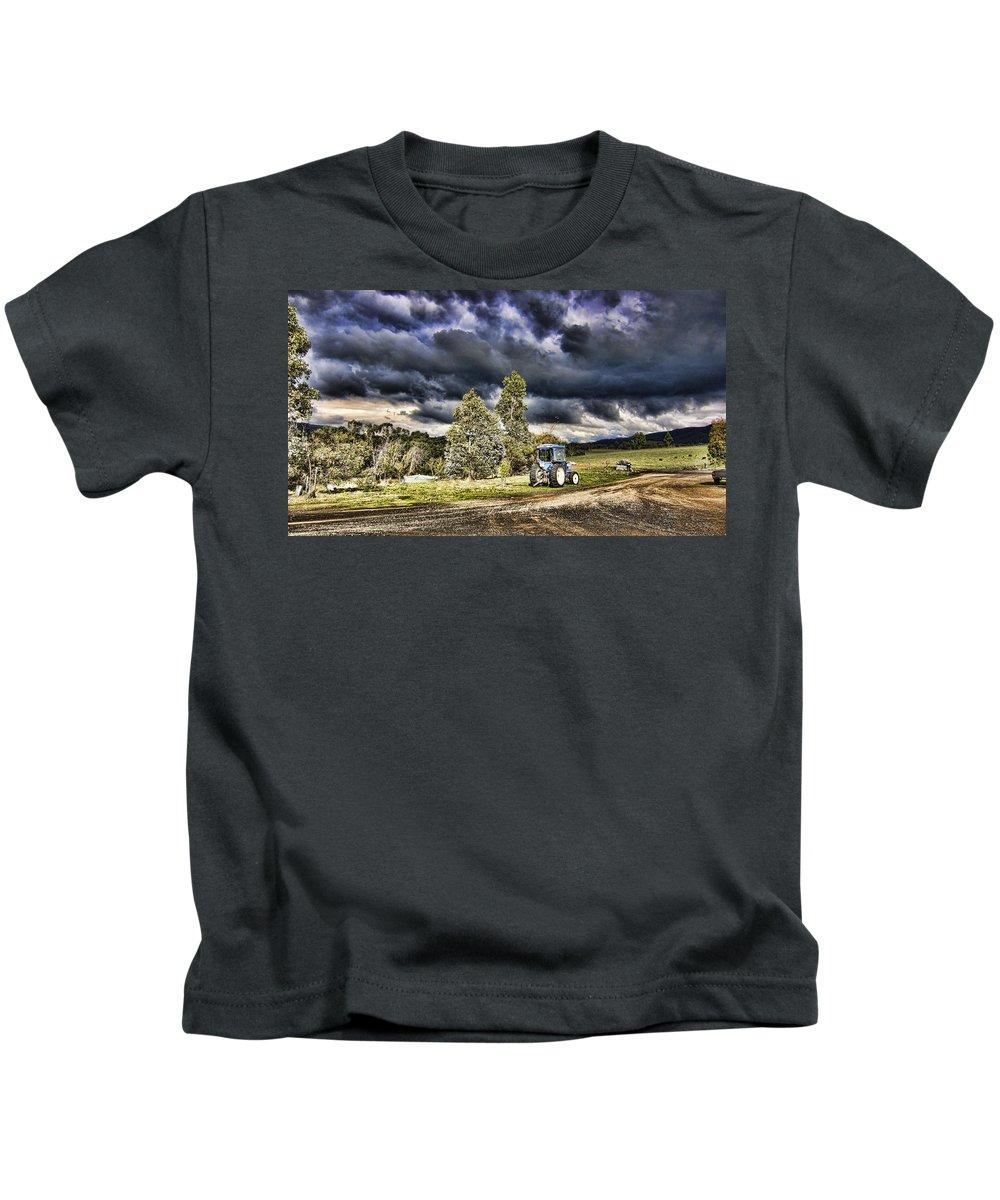 Dark Kids T-Shirt featuring the photograph Dark Clouds Over The Farm by Douglas Barnard