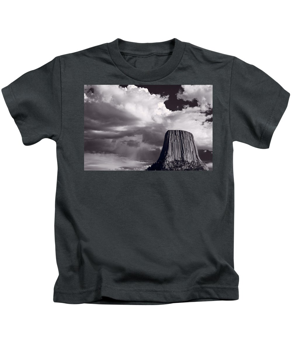 Devils Kids T-Shirt featuring the photograph Devils Tower Wyoming Bw by Steve Gadomski
