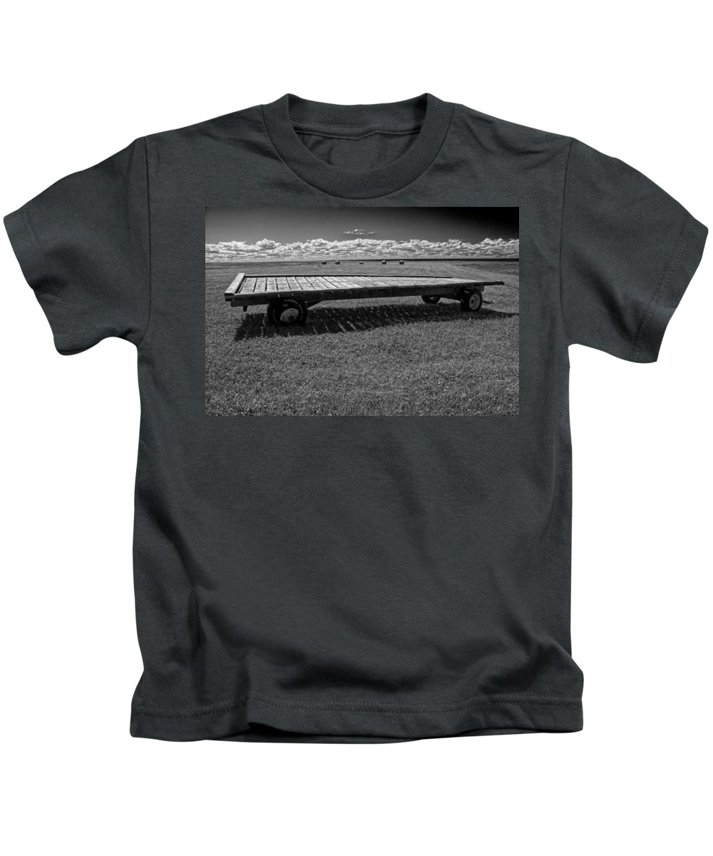 Art Kids T-Shirt featuring the photograph Farm Wagon In A Field On Prince Edward Island by Randall Nyhof