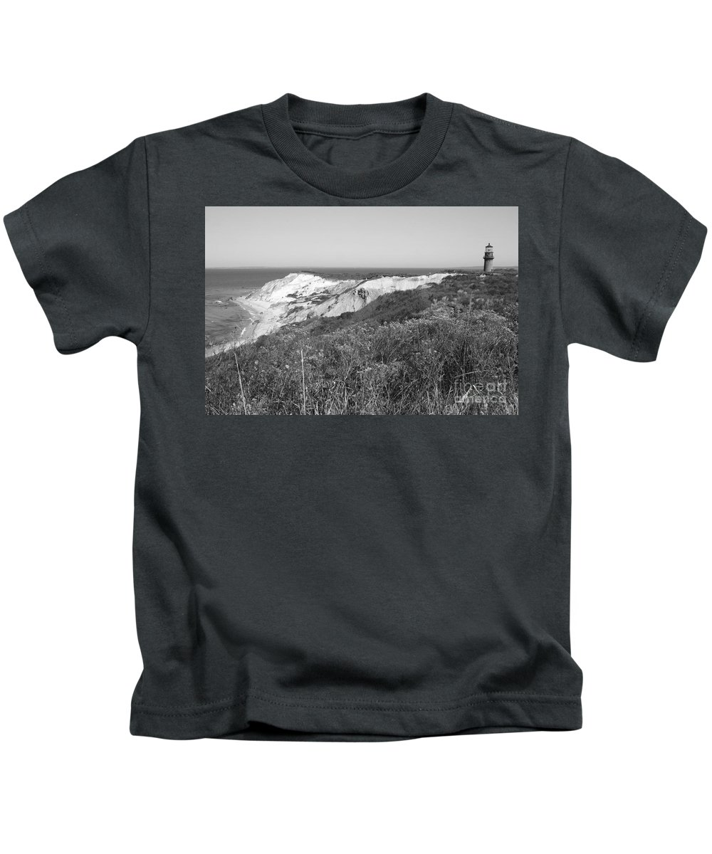 Gay Head Lighthouse With Aquinna Beach Cliffs - Black And White Kids T-Shirt featuring the photograph Gay Head Lighthouse With Aquinna Beach Cliffs - Black And White by Carol Groenen