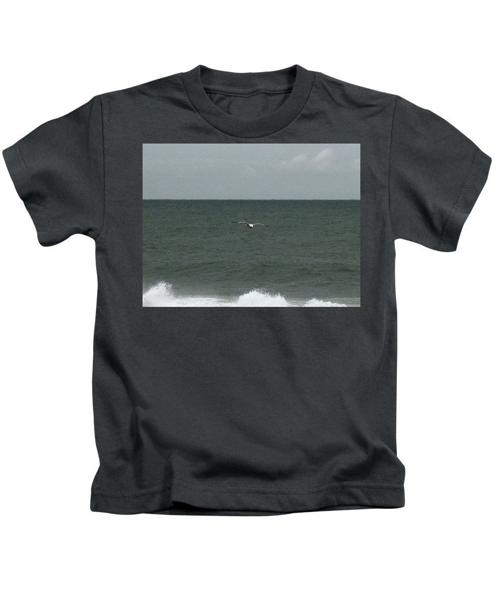 Seagull Kids T-Shirt featuring the photograph Gliding Over The Waves by Linda Hutchins