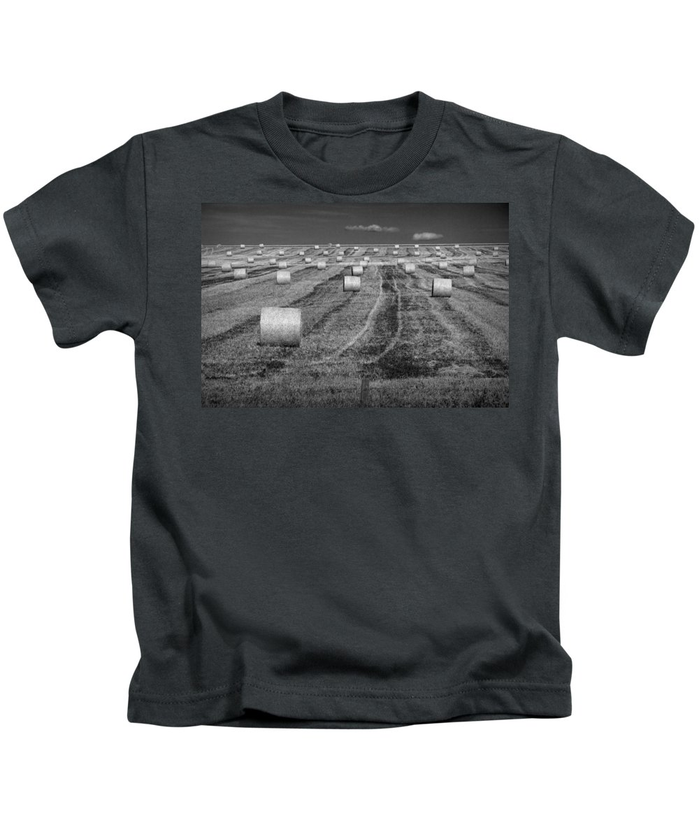 Art Kids T-Shirt featuring the photograph Hay Bales On A Farm In Alberta by Randall Nyhof