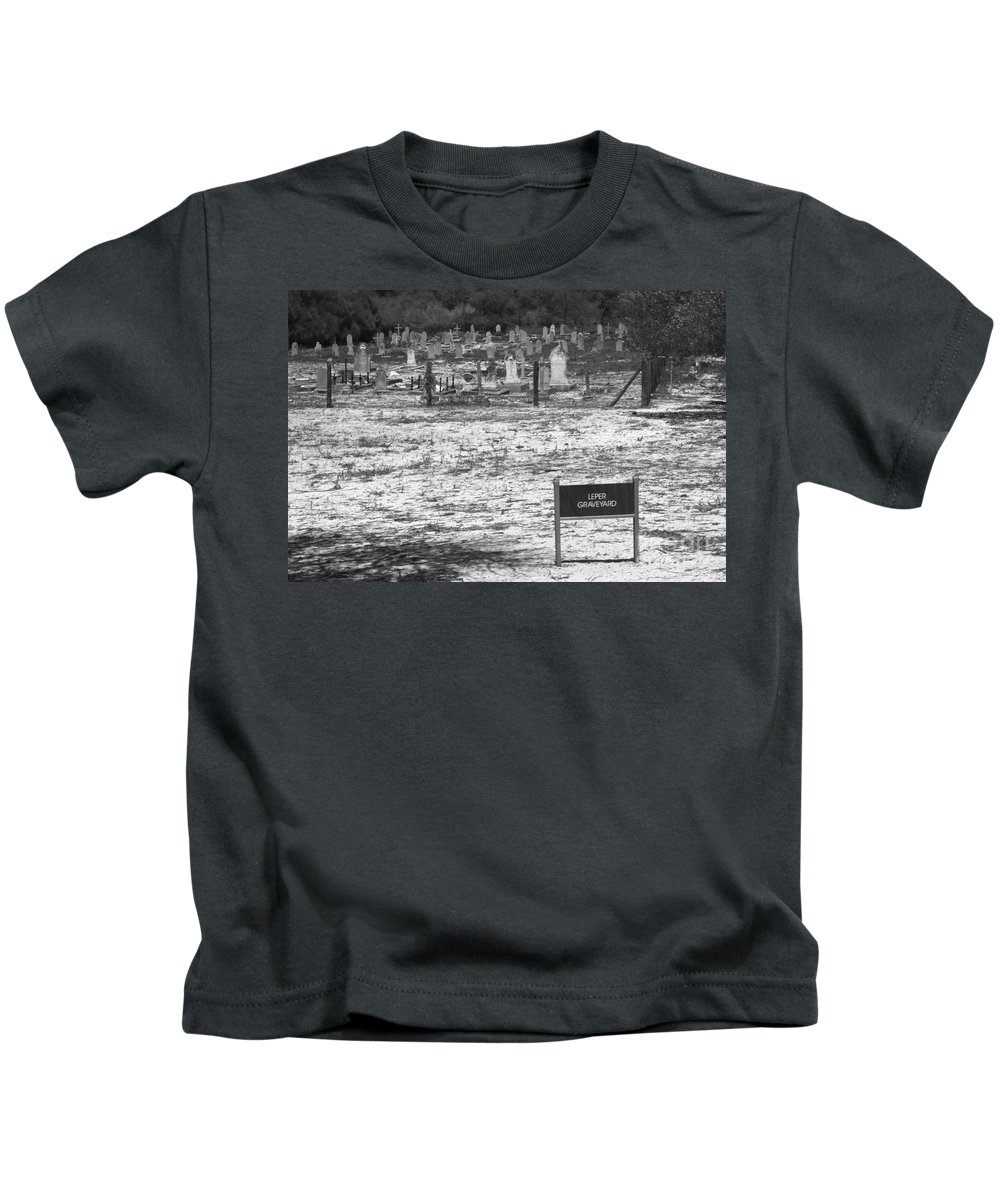 Robben Island Kids T-Shirt featuring the photograph Leper Graveyard On Robben Island by Aidan Moran