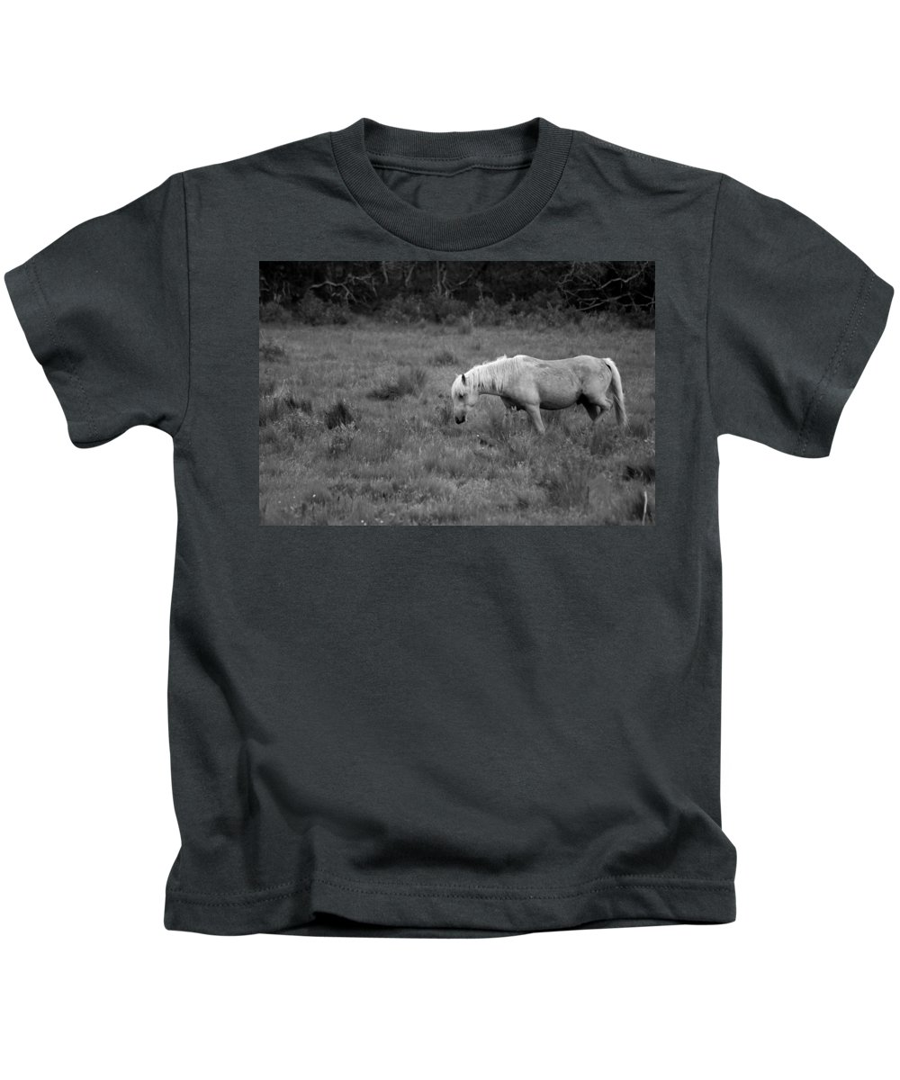 Pony Kids T-Shirt featuring the photograph Lonesome Pony by Lori Tambakis