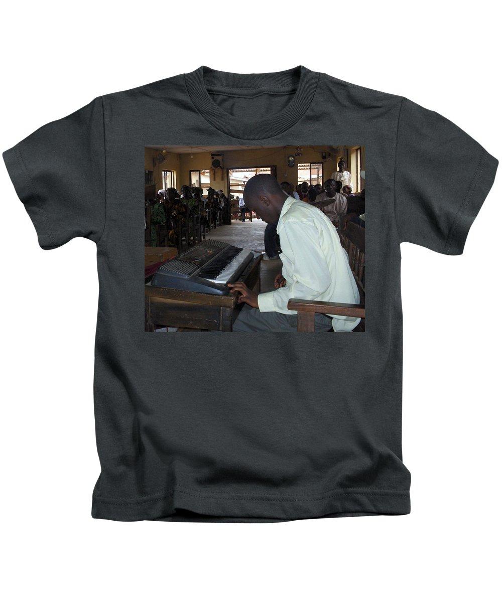 Piano Kids T-Shirt featuring the photograph Madona Playing Piano In Nigerian Church by Amy Hosp