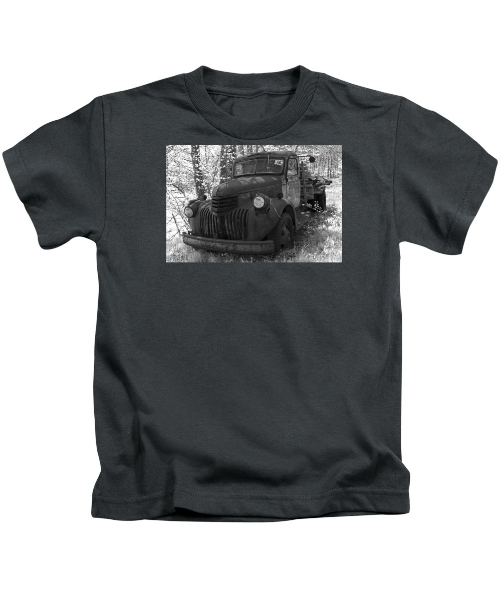 Rustic Kids T-Shirt featuring the photograph Retired Rusty Relic Farm Truck by John Stephens