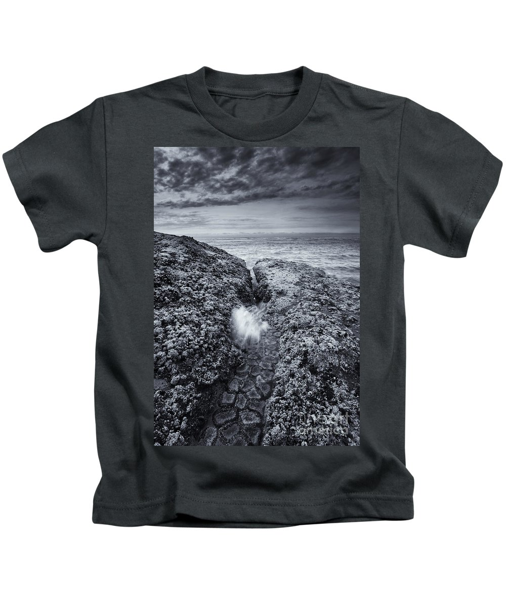 Coast Kids T-Shirt featuring the photograph Squeezing Through Every Crack by Mike Dawson