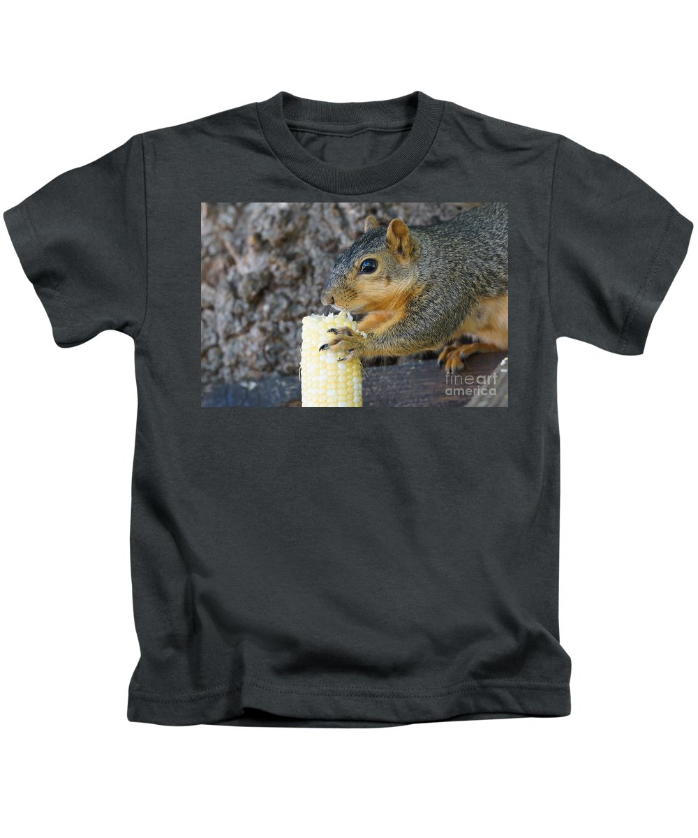 Squirrel Kids T-Shirt featuring the photograph Squirrel Holding Corn by Lori Tordsen