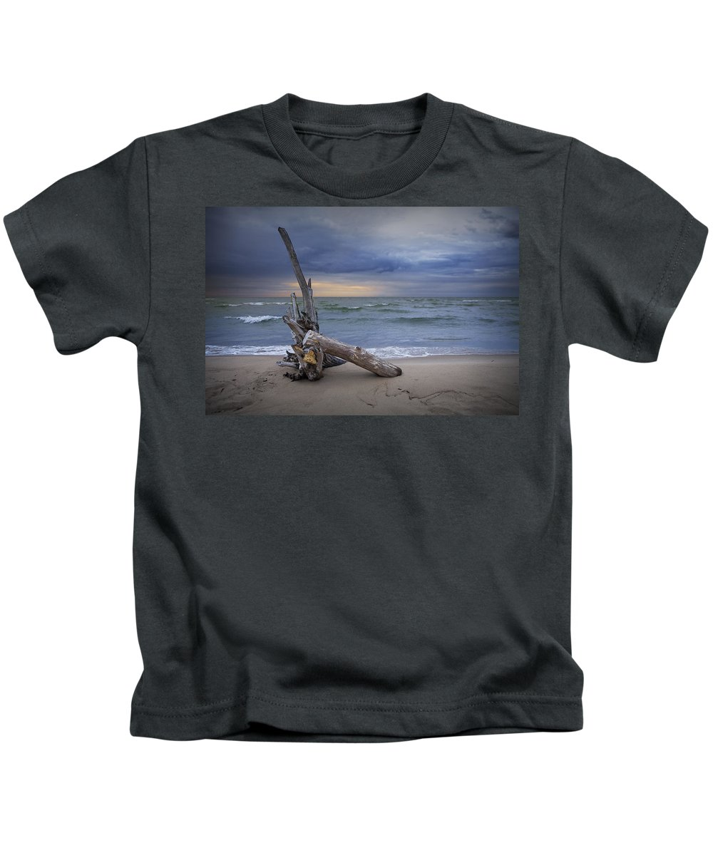 Art Kids T-Shirt featuring the photograph Sunrise On The Beach With Driftwood At Oscoda by Randall Nyhof