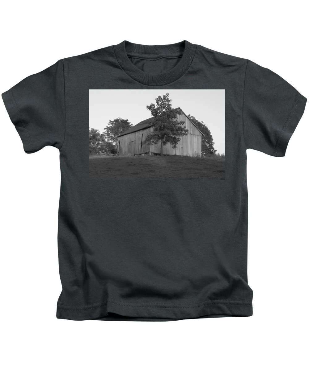 Black And White Kids T-Shirt featuring the photograph Tobacco Barn II In Black And White by JD Grimes
