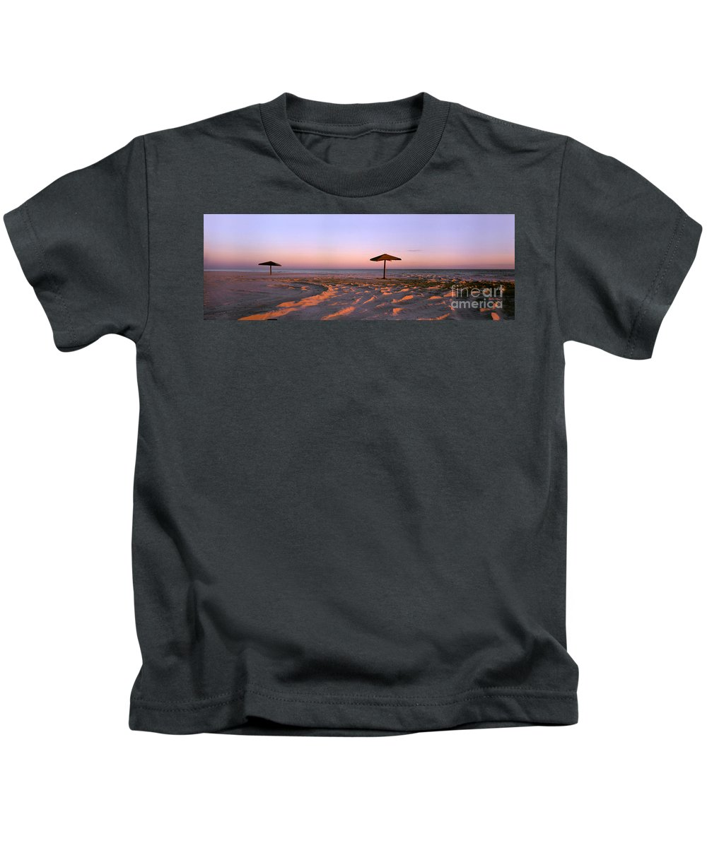 Beach Kids T-Shirt featuring the photograph Two Beach Umbrellas by Mike Nellums