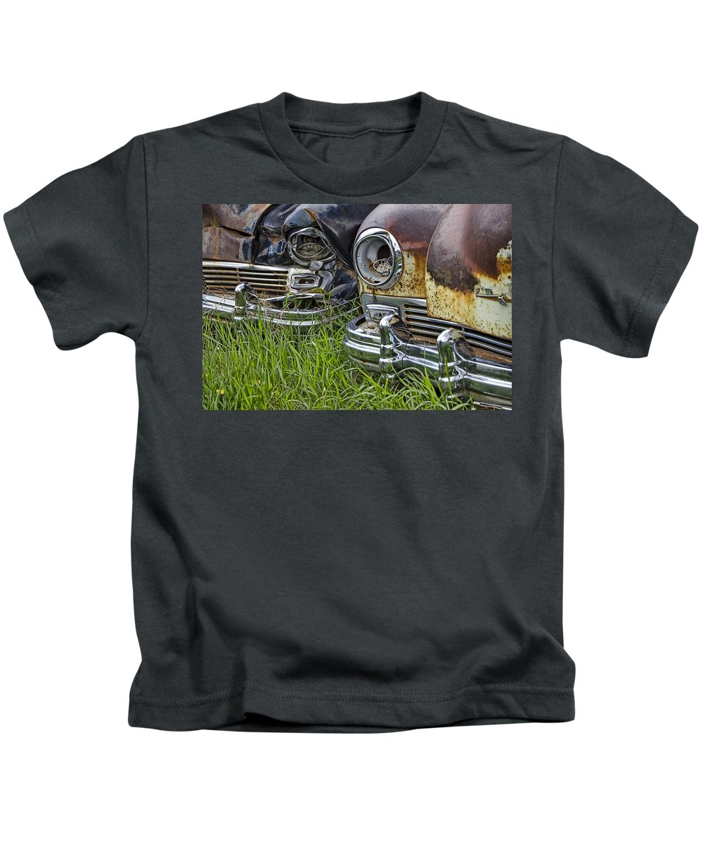 Art Kids T-Shirt featuring the photograph Vintage Frazer Auto Wreck Front Ends by Randall Nyhof