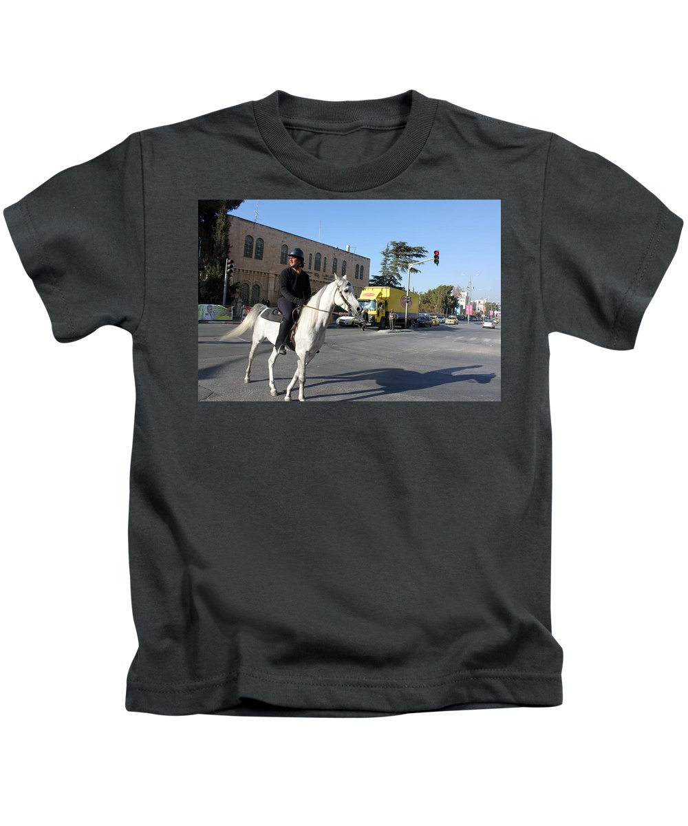 White Kids T-Shirt featuring the photograph White Horse In Bethlehem Street by Munir Alawi
