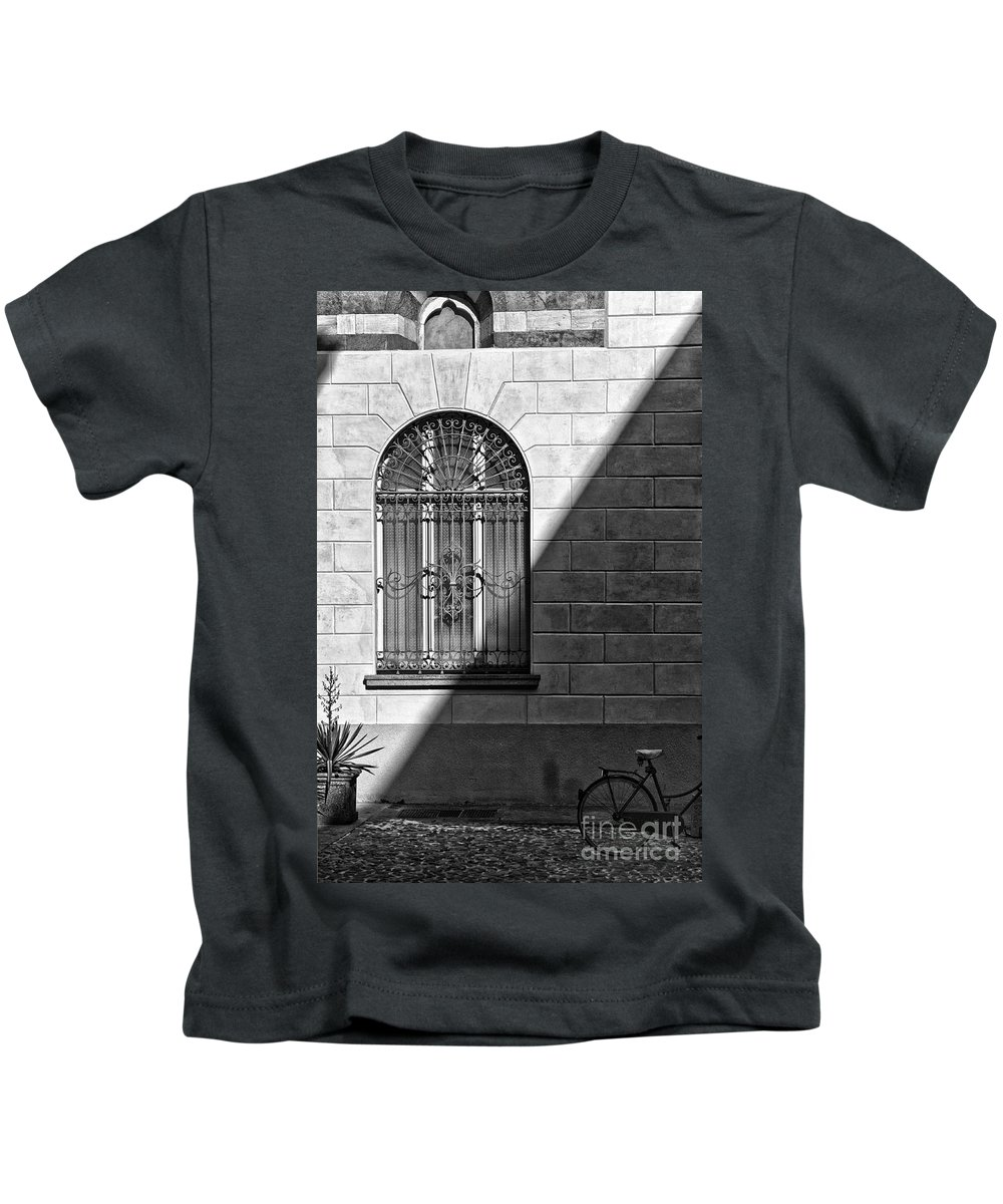 Black And White Kids T-Shirt featuring the photograph Window And Shadow On A Wall With Bike by Silvia Ganora