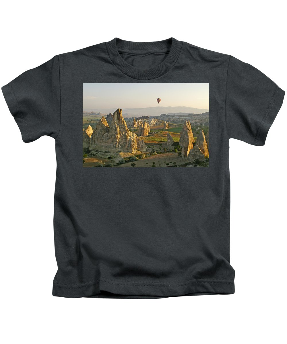 Turkey Kids T-Shirt featuring the photograph Ballooning In Cappadocia by Michele Burgess