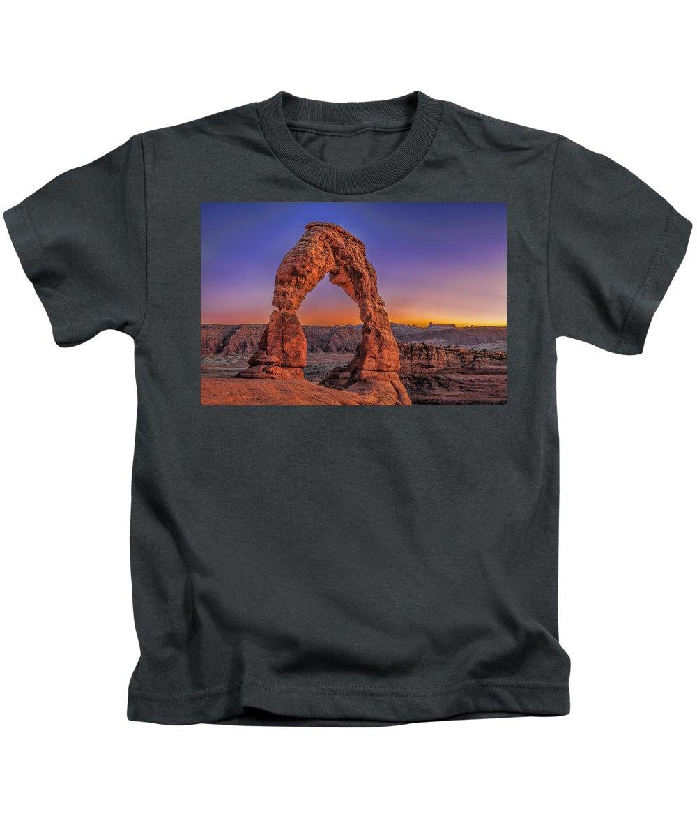 Rocks Park Utah Arches Color Sunset Dusk Purple Light Desert Unique Kids T-Shirt featuring the photograph Delicate Arch by LOsorio Photography