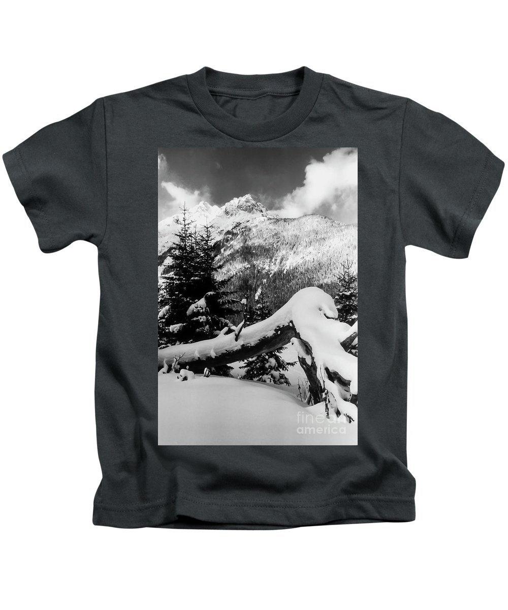 Leutasch Germany Snow Tree Trunk Trees Mountain Mountains Landscape Landscapes Snowscape Snowscapes Black And White Kids T-Shirt featuring the photograph Mountain Snow 2 by Bob Phillips