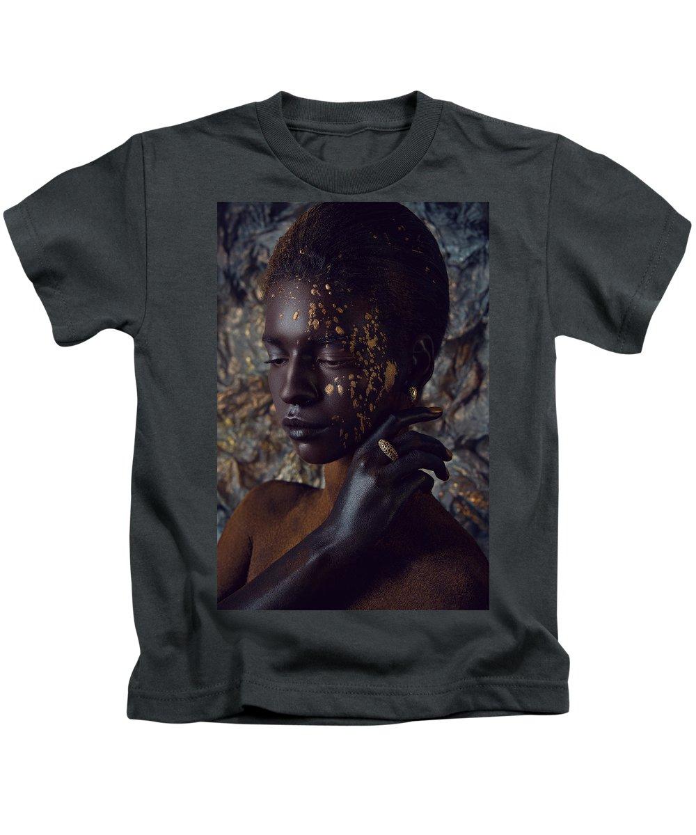 Beauty Shot Kids T-Shirt featuring the photograph Woman In Splattered Golden Facial Paint by Veronica Azaryan