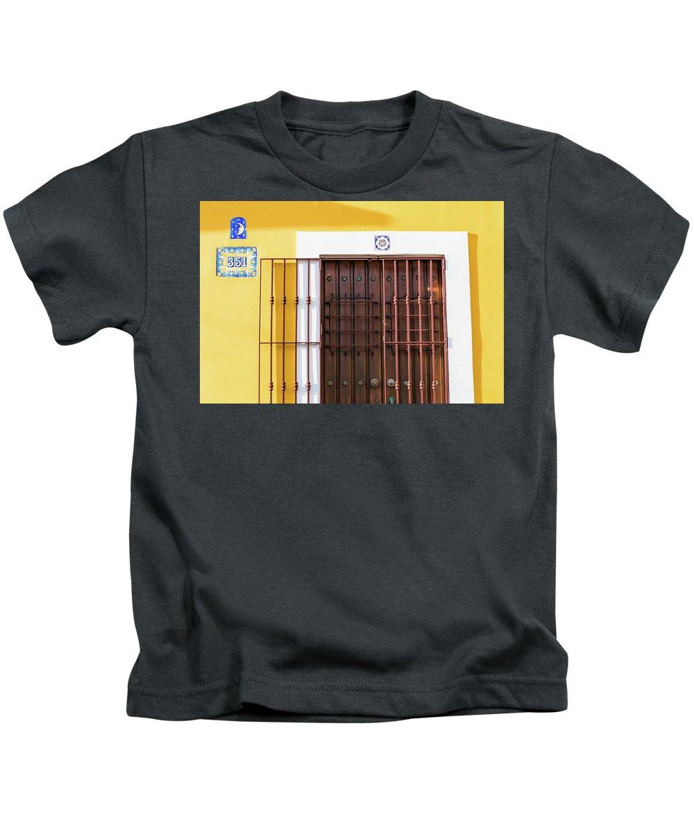 Urban Kids T-Shirt featuring the photograph Wooden Door In Old San Juan, Puerto Rico by Jasmin Burton