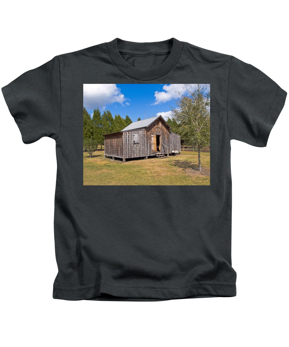 Cabin Kids T-Shirt featuring the photograph 1905 Florida Wheeler Board And Batten House by Allan Hughes