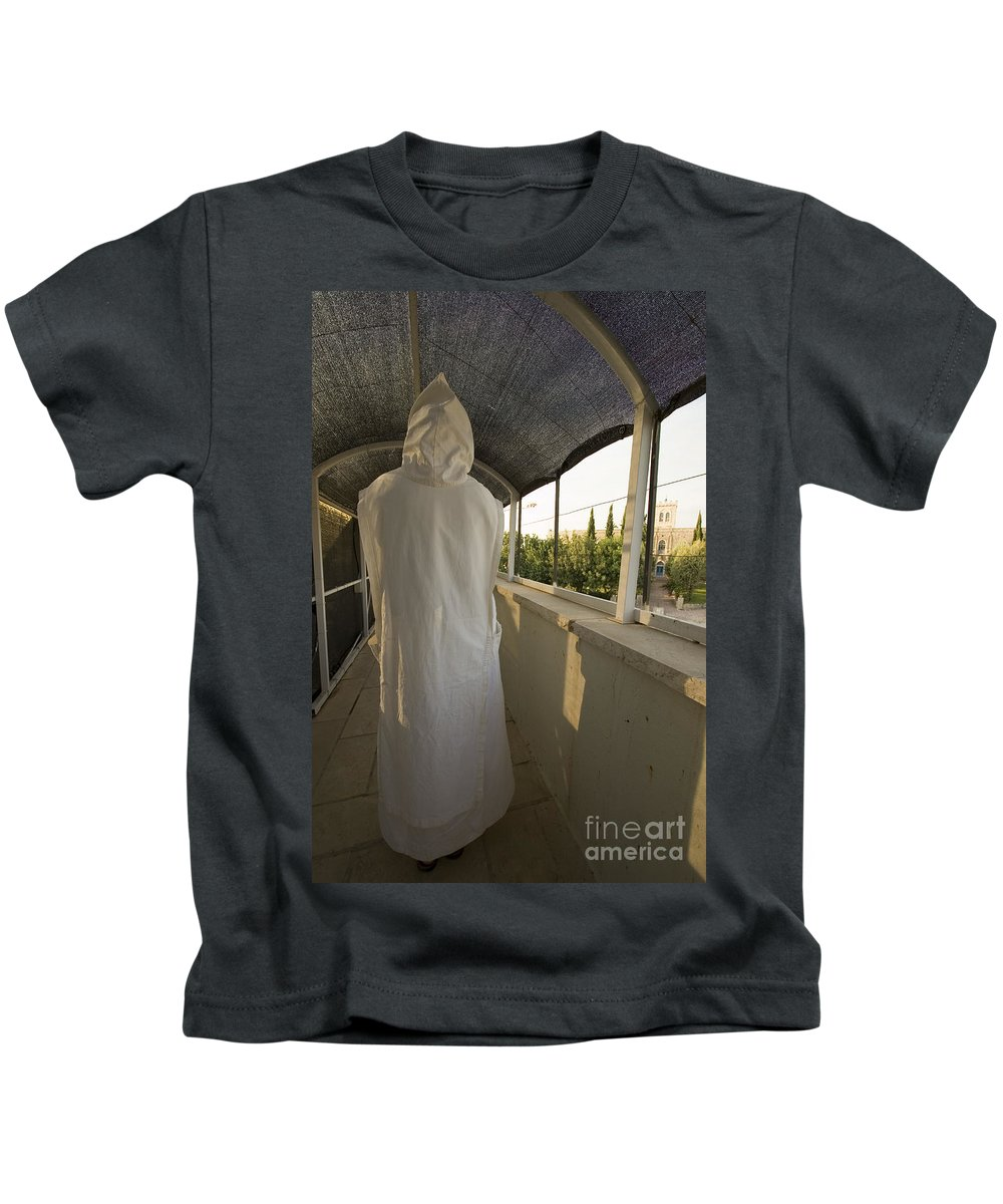 Nun Kids T-Shirt featuring the photograph A Nun In A Monastery by Danny Yanai