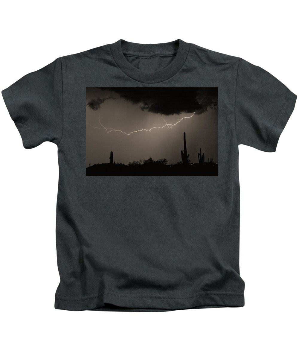 Lightning Kids T-Shirt featuring the photograph Across The Desert - Sepia Print by James BO Insogna