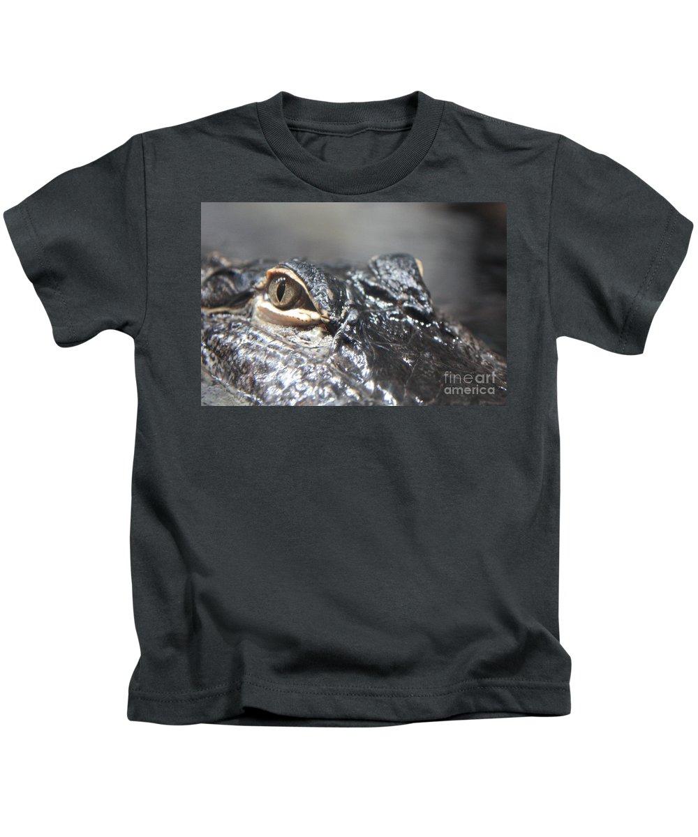 Alligator Kids T-Shirt featuring the photograph Alligator Eye by Carol Groenen