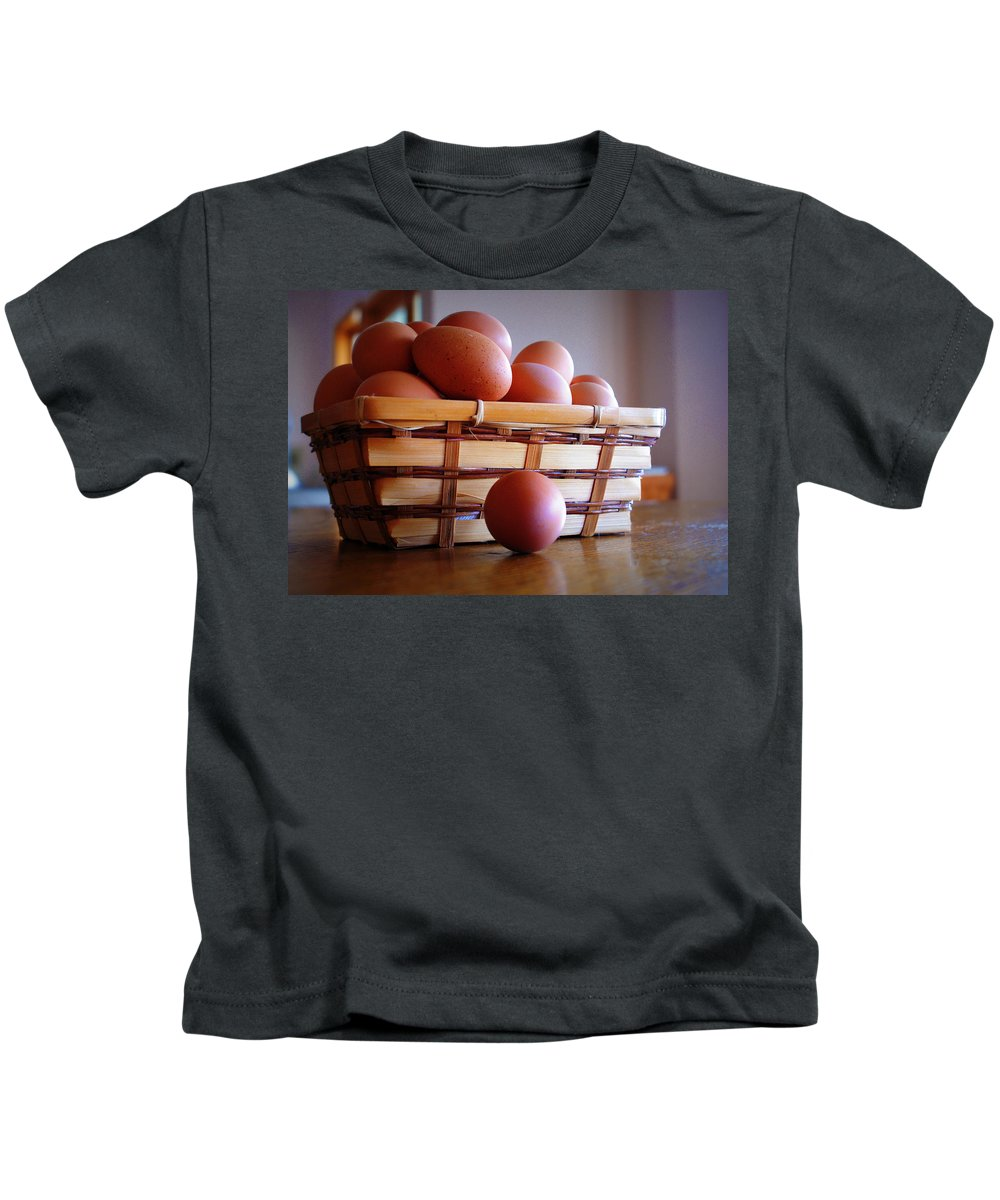 Egg Kids T-Shirt featuring the photograph Almost All My Eggs In One Basket by Cricket Hackmann