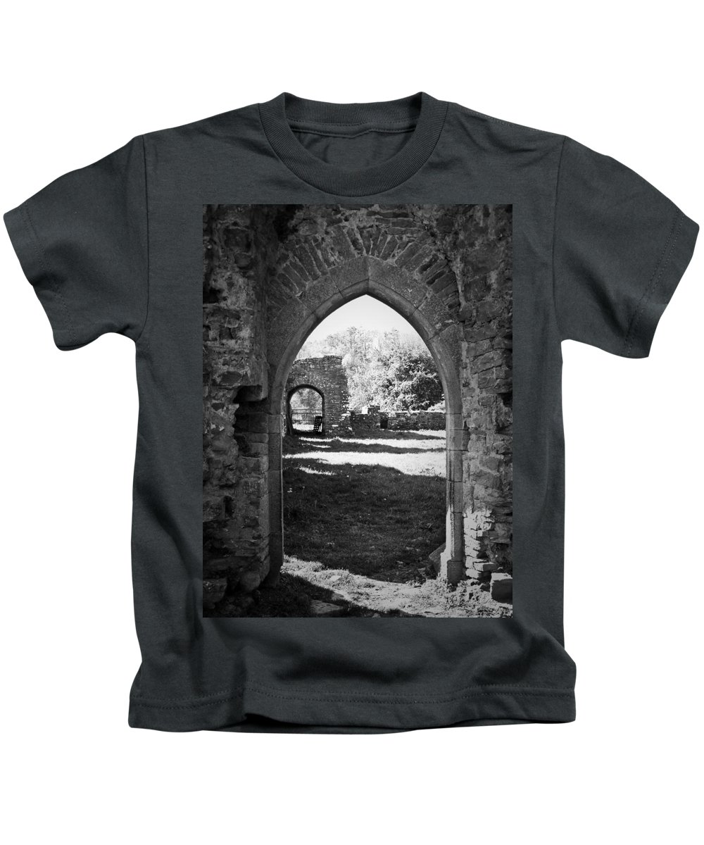 Irish Kids T-Shirt featuring the photograph Arched Door At Ballybeg Priory In Buttevant Ireland by Teresa Mucha