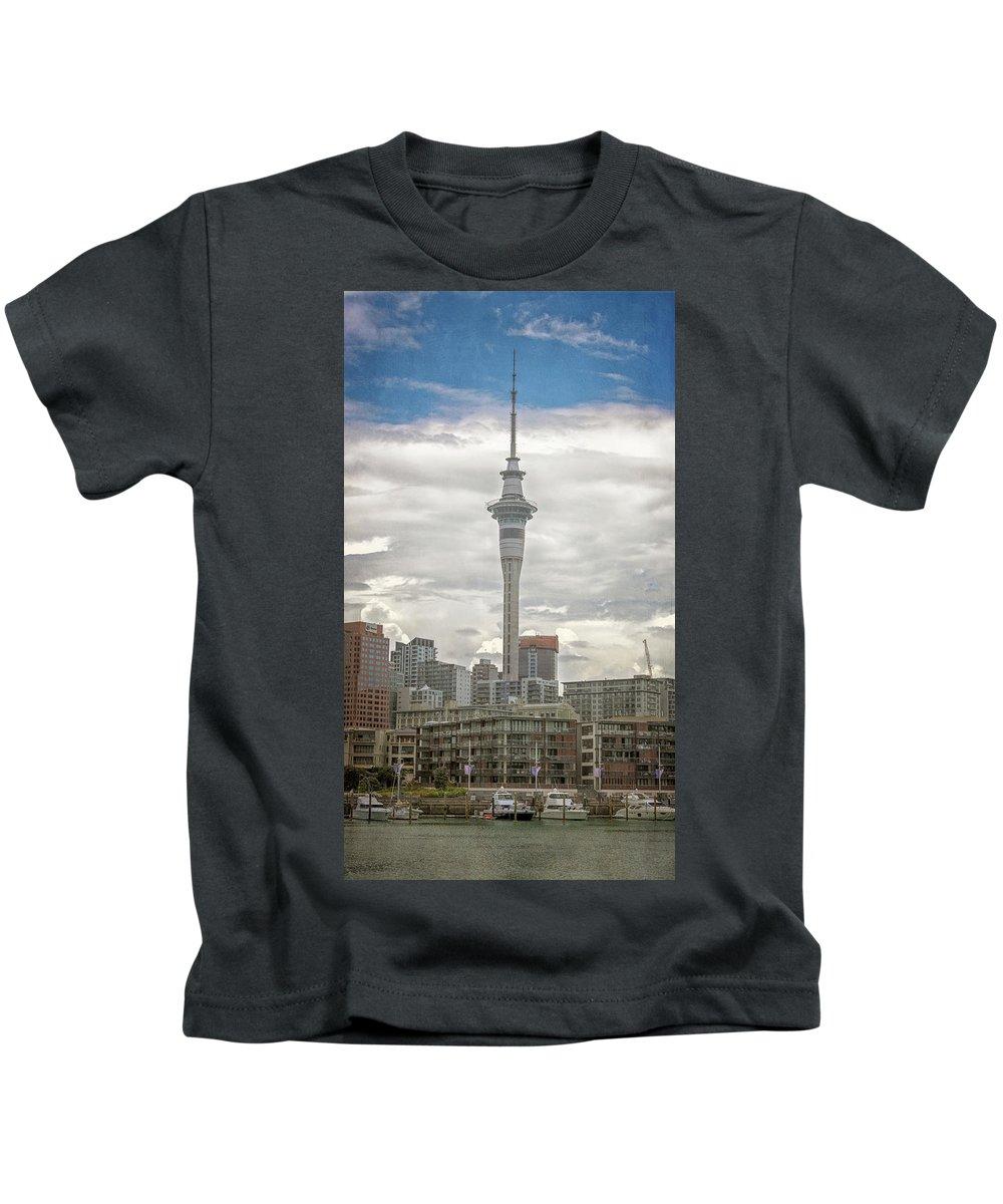 Joan Carroll Kids T-Shirt featuring the photograph Auckland New Zealand Sky Tower Textured by Joan Carroll