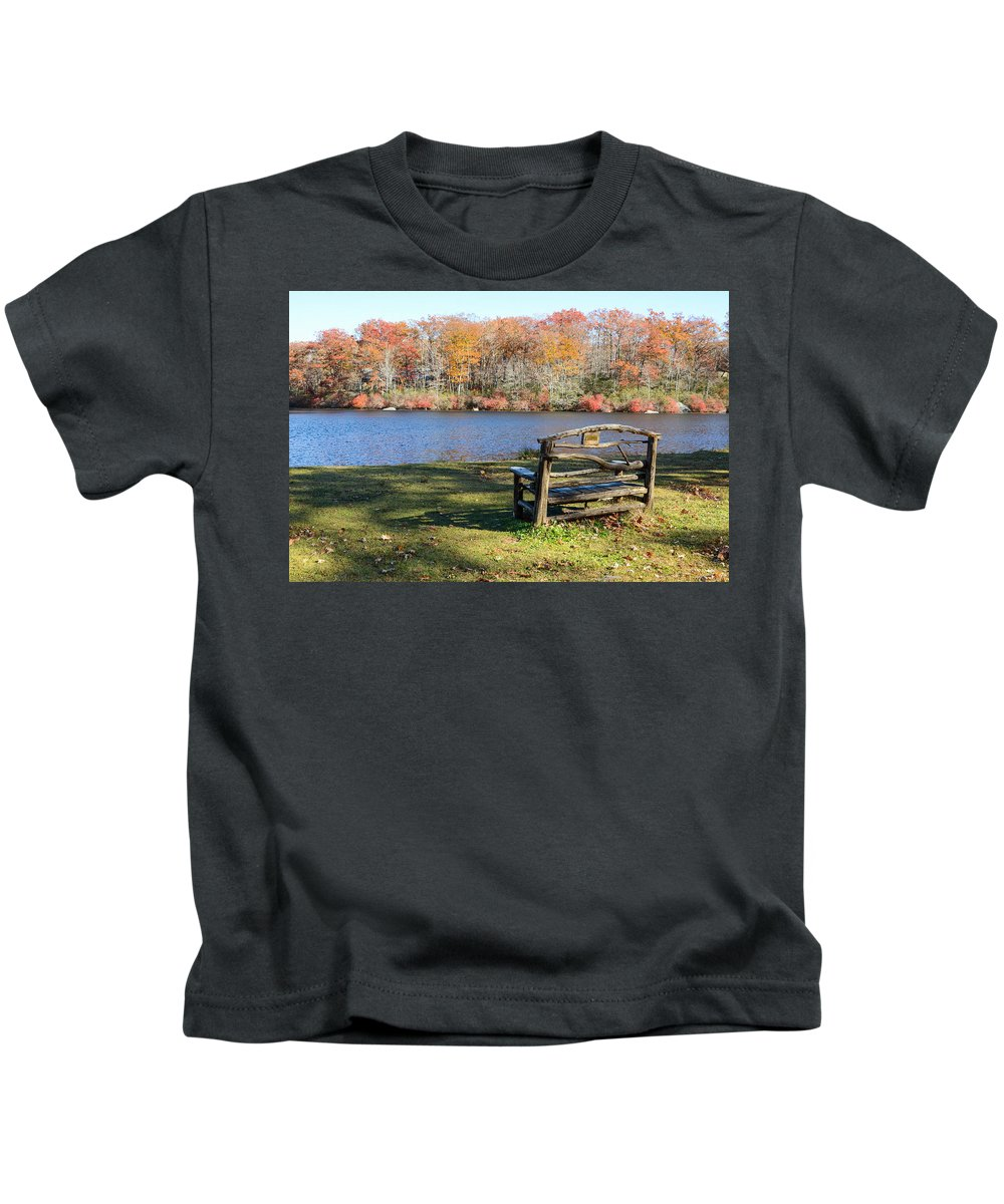 Harriman State Park Ny New York State Seven Lakes Drive Lake Kanawauke Wooden Bench Fall Colors Kids T-Shirt featuring the photograph Bench On Lake by Steven Riker