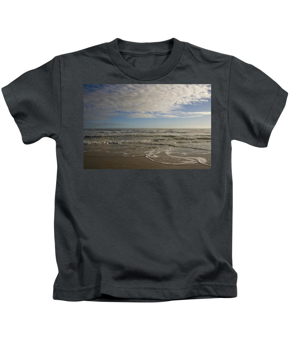 Wave Sand Ocean Beach Sky Water Wave Tide Sun Sunny Vacation Cloud Morning Early Kids T-Shirt featuring the photograph Between Night And Day by Andrei Shliakhau