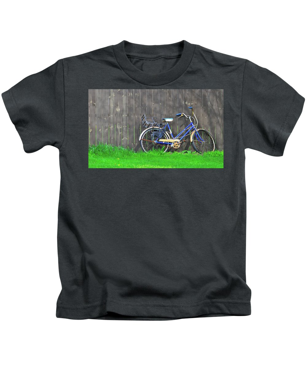 Bicycle Kids T-Shirt featuring the photograph Bicycle And Gray Fence by David Arment