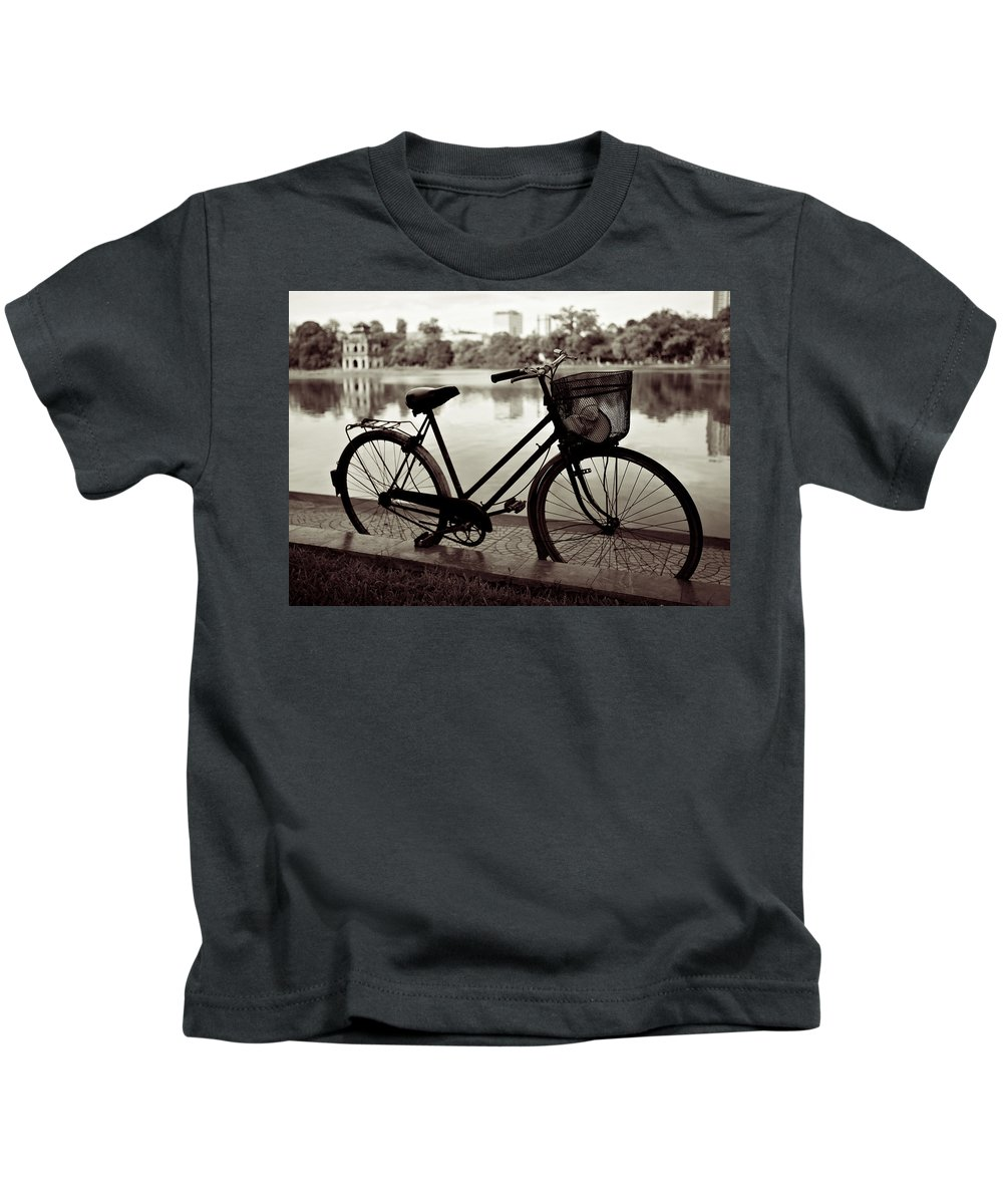 Bicycle Kids T-Shirt featuring the photograph Bicycle By The Lake by Dave Bowman