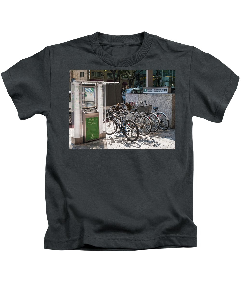 Area Kids T-Shirt featuring the photograph Bicycle Parking And Smoking Station In Tokyo Japan by Jacek Malipan