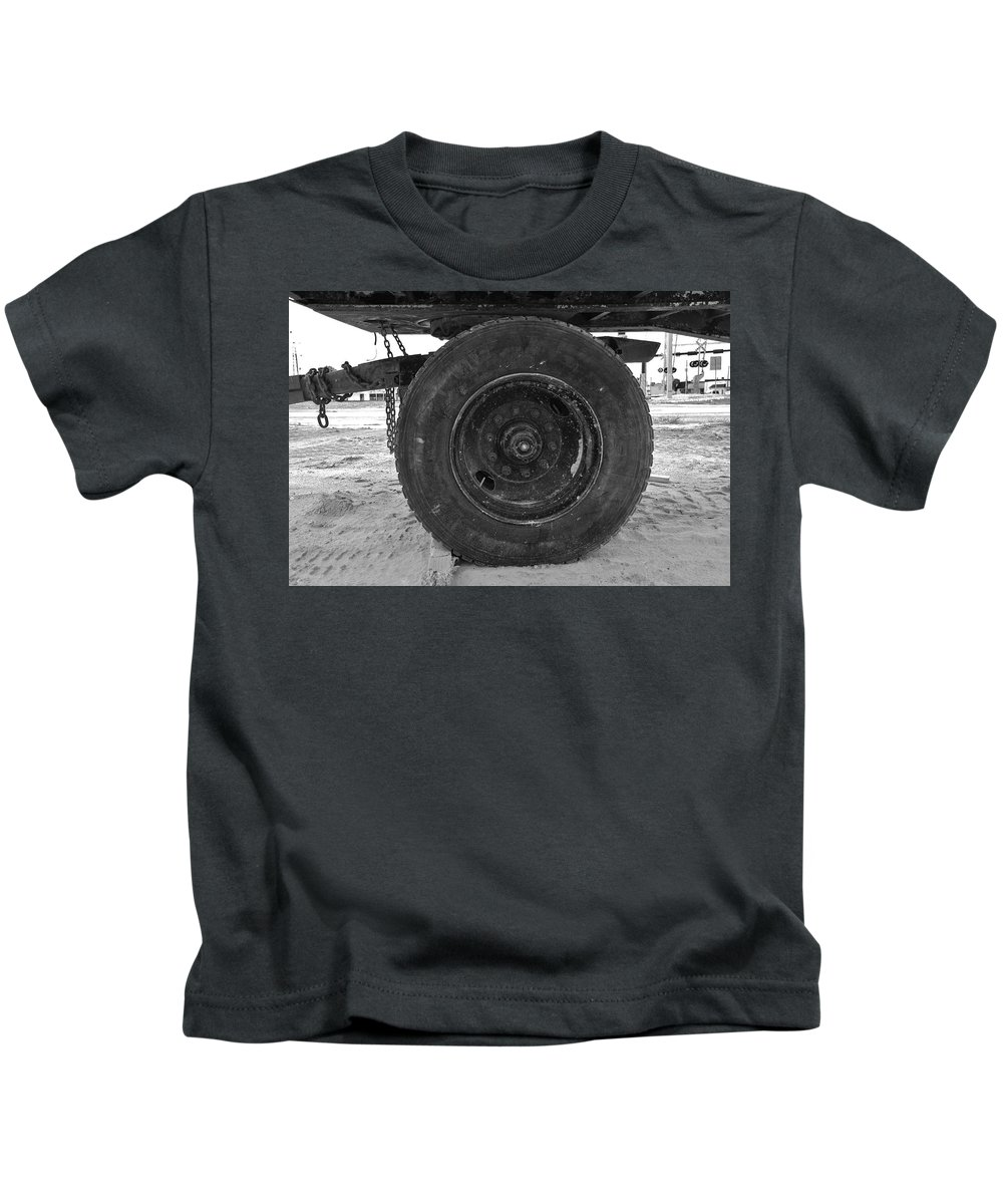 Black And White Kids T-Shirt featuring the photograph Black Wheel by Rob Hans