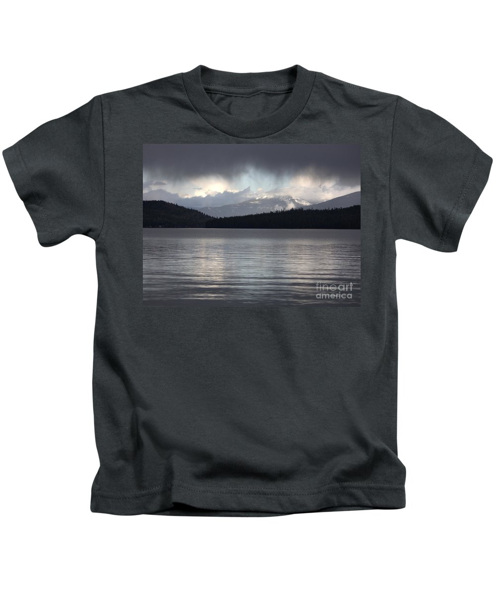 Clouds Kids T-Shirt featuring the photograph Blue Sky Through Dark Clouds by Carol Groenen