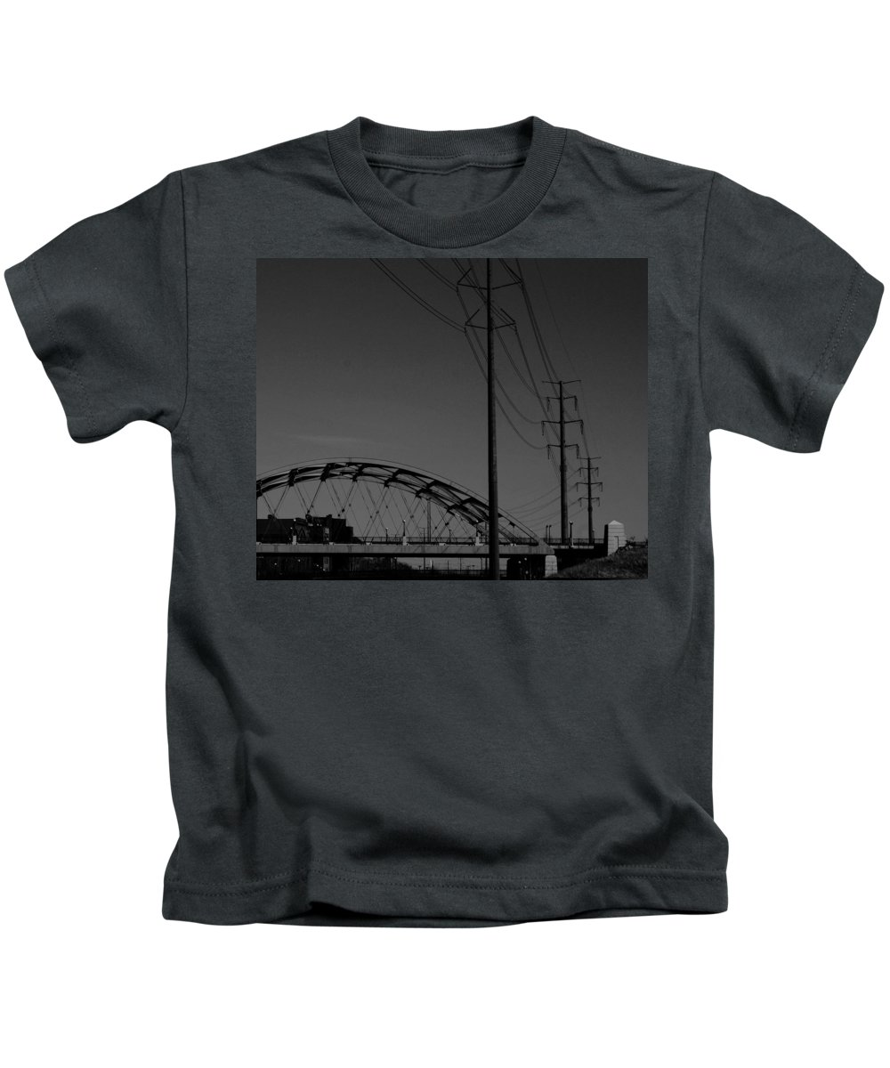 Metal Structures Kids T-Shirt featuring the photograph Bridge And Power Poles At Dusk by Angus Hooper Iii