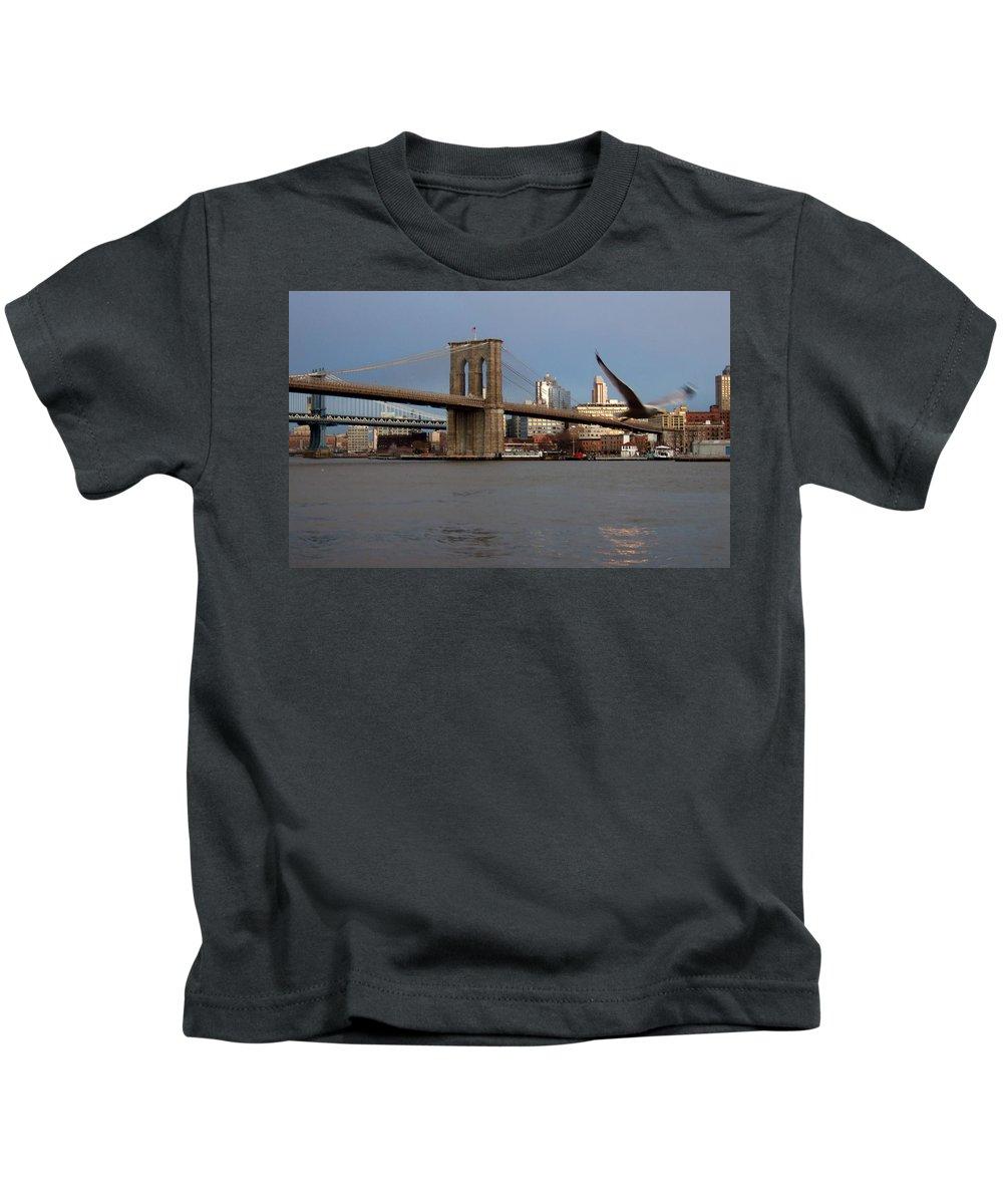 Brooklyn Bridge Kids T-Shirt featuring the photograph Brooklyn Bridge And Bird In Flight by Anita Burgermeister