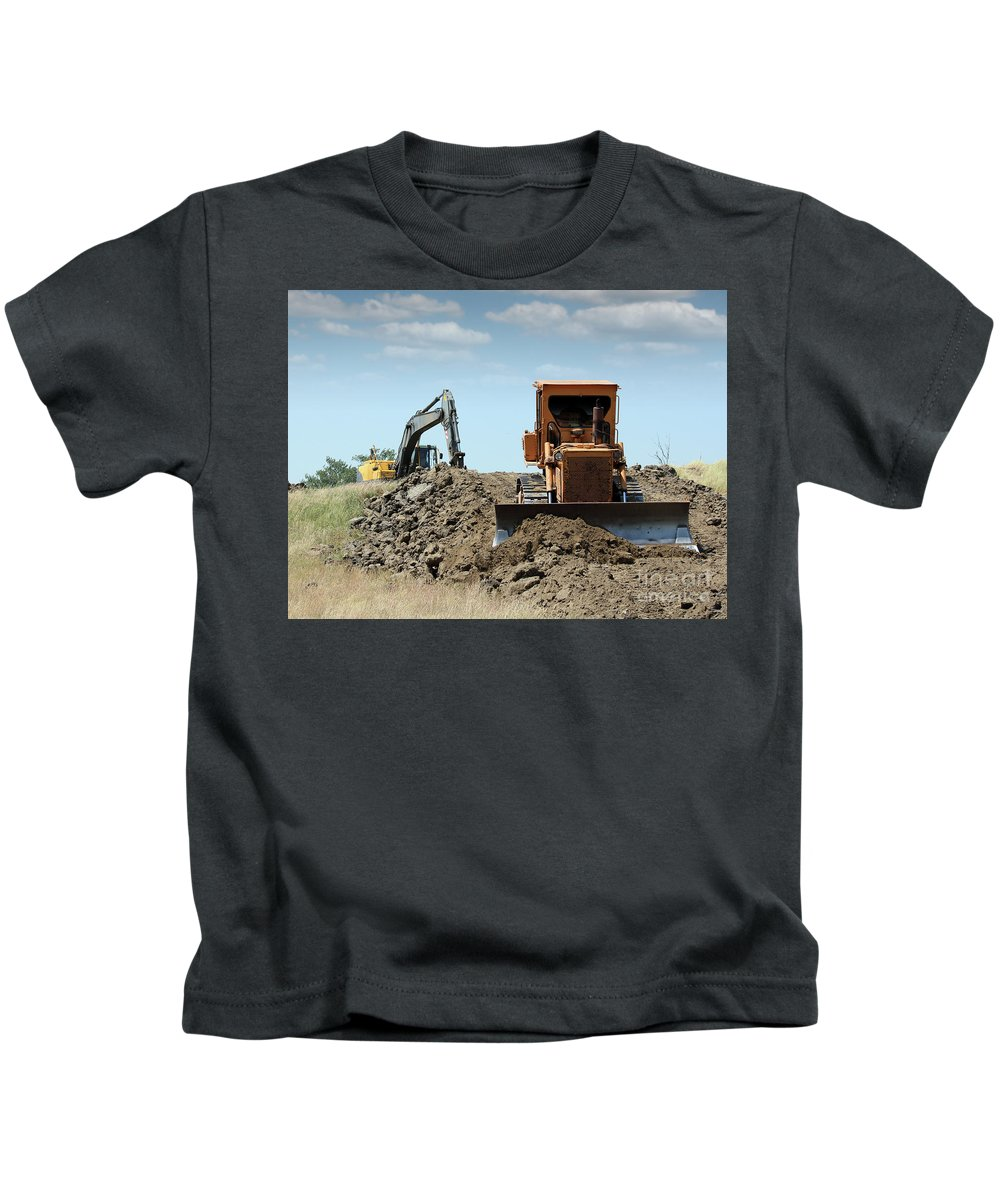 Bulldozer Kids T-Shirt featuring the photograph Bulldozer And Excavator On Road Construction by Goce Risteski