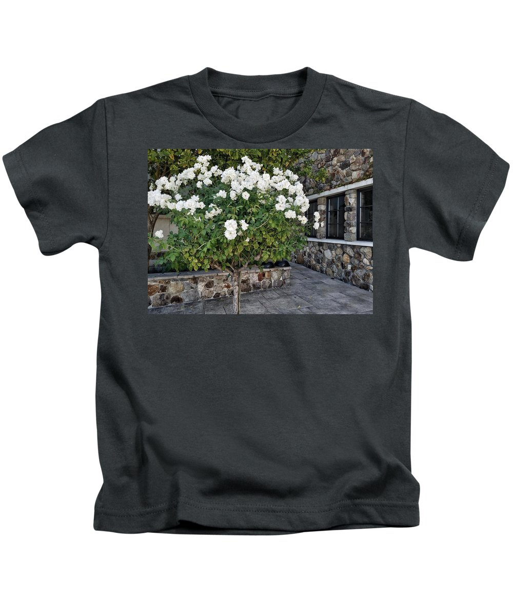 Camellia Kids T-Shirt featuring the photograph Camellia Blossoms by Mary Capriole