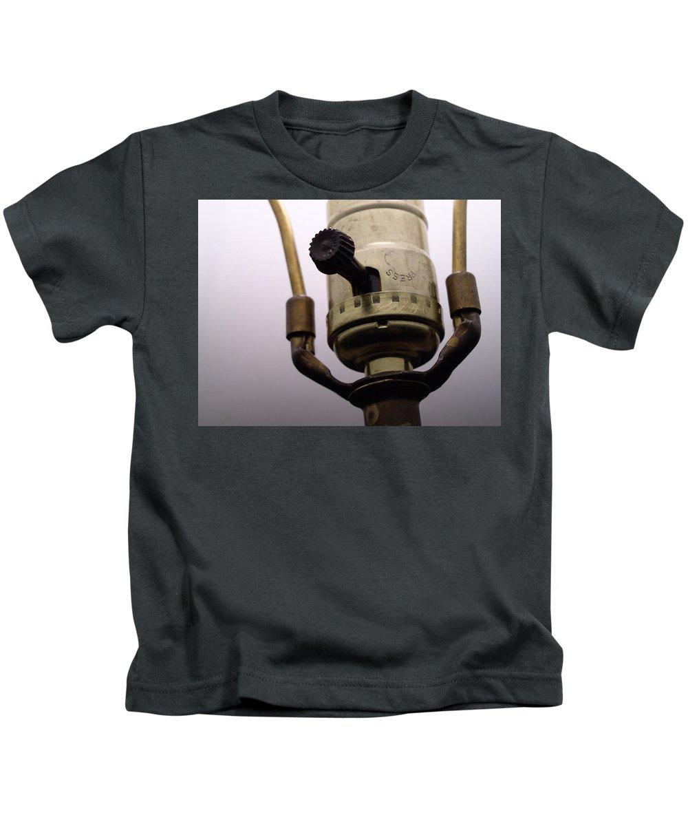 Kids T-Shirt featuring the photograph Closeup Lampswitch by Erik Burg